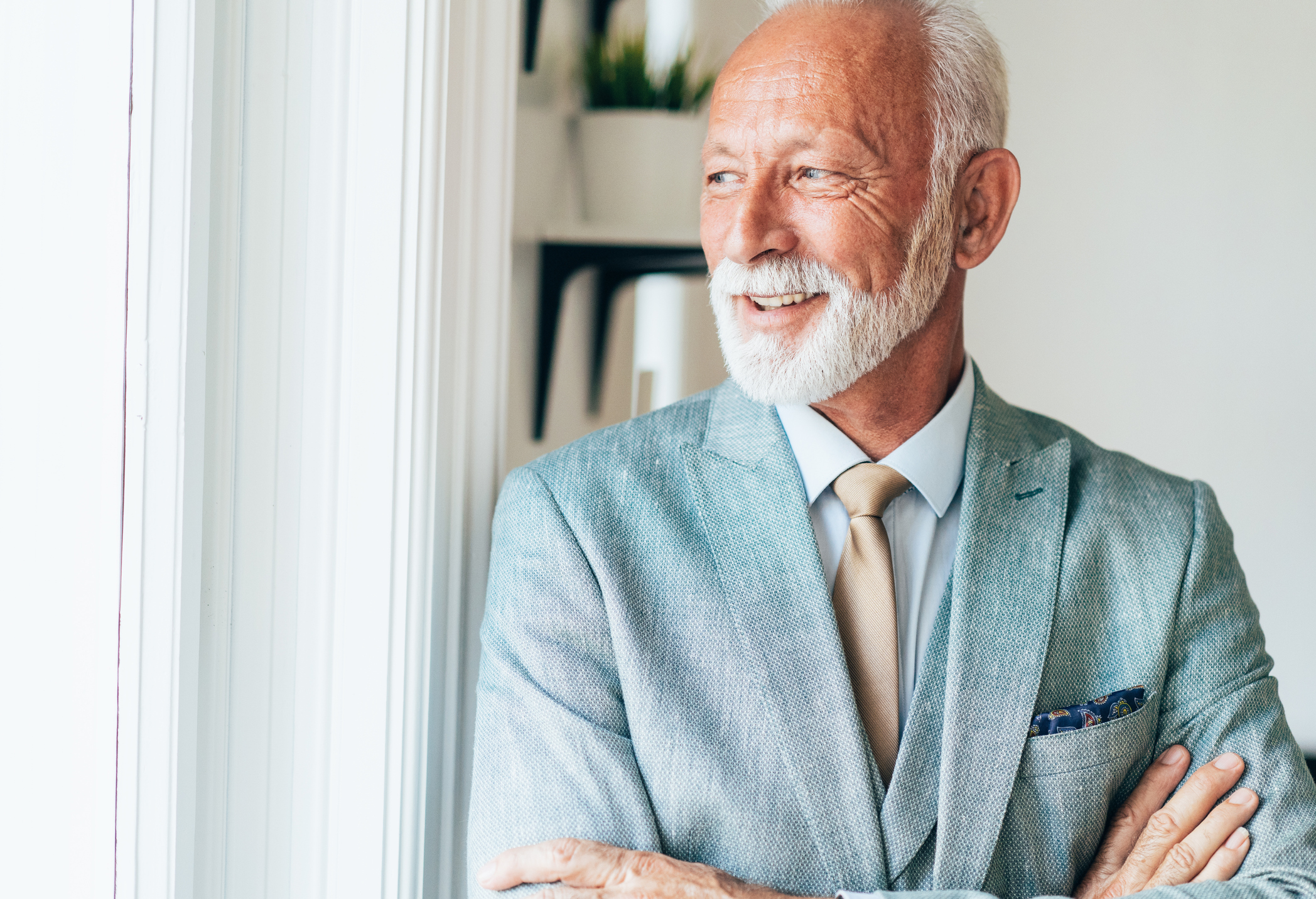 Mature Man Wearing a Grey Suit